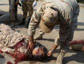 شاهد.. تناثر جثث القتلى بعد الهجوم على العرض العسكرى فى الأحواز
