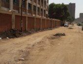 قارئ يناشد محافظ الجيزة رصف شارع مجمع المدارس بأرض اللواء