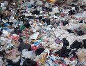 قارئ يشكو تراكم القمامة بشارع الصحابة فى أبو النمرس بالجيزة