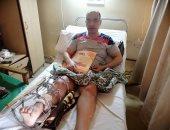 """صور.. خطأ طبى يحول حياة """"مصطفى"""" لجحيم.. وزوجته تناشد وزارة الصحة لإنقاذه"""