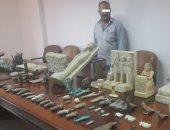 حبس صاحب محل مشغولات ذهبية ونجله لحيازتهما 70 قطعة أثرية بالأميرية