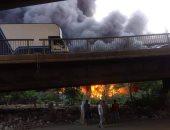 قوات الحماية المدنية تسيطر على حريق أعلى كوبرى قها بالقليوبية