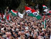 صور.. المئات يحتفلون بالذكرى الـ62 للثورة الهنجارية بالمجر