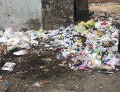 قارئة ترصد تراكم القمامة أمام مدرسة سان جورج فى مدينة نصر