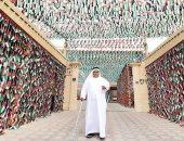 فى يوم الإمارت للَعَلم.. إماراتى يرفع 140 ألف عَلم فوق منزله