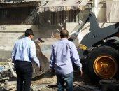 حى الضواحى ببورسعيد يزيل السوق العشوائى بمنطقة فاطمة الزهراء