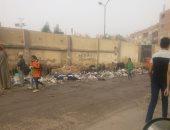 القمامة تحاصر أسوار مدرسة زهور وبراعم ترسا فى الجيزة