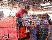 صورة اليوم.. شيال الحمول فى سوق العبور
