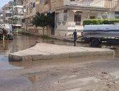 رفع تجمعات مياه الأمطار من شوارع رأس البر
