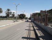 قارئ يرصد إضاءة أعمدة الإنارة نهارا بشارع المستشفى فى بنى سويف