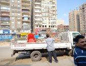 حملات مكثفة بأحياء القاهرة لإخلاء الأرصفة من الإشغالات