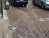 سكان شارع مسجد عباد الرحمن يبشتيل فى الجيزة يشكون من تراكم المياه