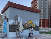 """طلاب """"تربية فنية"""" يزينون حى الأسمرات 3 بالجرافيتى.. ورسالة من متحدث الإسكان"""