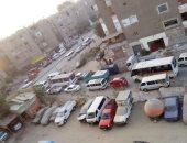 شكوى من انتشار الجراجات بشارع ترعة الزمر بالعمرانية