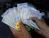 أه لو لعبت يازهر.. التايلانديون يتقربون لشجرة الحظ من أجل اليانصيب (صور)