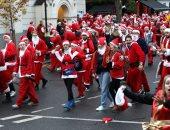 """سكان نيويورك يتنكرون فى زى """"بابا نويل"""" خلال مهرجان """"سانتاكون"""""""