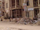 قارئ يشكو من انتشار القمامة فى مبنى شبه أثرى بسوهاج.. صور