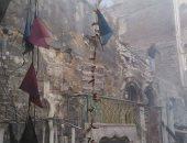 """صور.. """"عقب سيجارة"""" يتسبب فى انهيار عقار بوسط الإسكندرية"""