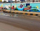 فنان يصمم جدارية طولها 75 مترا على جدران دسوق تخليدا لتاريخها.. صور