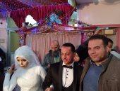 صور.. عروسان يجريان الكشف الطبى ضمن مبادرة 100 مليون صحة بكفر الشيخ