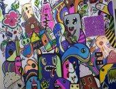 """""""دنيا"""" تشارك برسومات فنية لـ""""بورتريه مانديلا"""" باستخدام الألوان"""