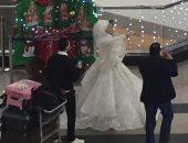 صور.. أول عروسين يغادران مطار القاهرة فى 2019