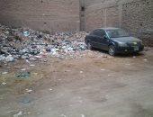 شكوى من تراكم القمامة داخل قطعة أرض خالية بشارع عرفة فى البراجيل