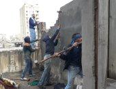 صور .. تنفيذ 5 قرارات إزالة لعقارات مخالفة وسط الأسكندرية
