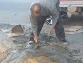 """حى الوايلى يستجيب لـ""""اليوم السابع"""" بردم حفرة أمام جامعة عين شمس"""
