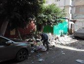 قارئ يشكو تراكم القمامة بجوار مدرسة الزهراء الابتدائية فى المنصورة