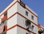 صور.. استمرار العمل في مبادرة طلاء واجهات العمارات فى بورسعيد