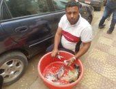 """صور.. """"محمد"""" صياد منذ 20 عاما: """"مصر حالها اتحسن وياريت الشباب تنزل تشتغل"""""""