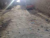 قارئ يشكو من تهالك وظلام طريق امتداد المعهد الدينى وانتشار القمامة بالوراق