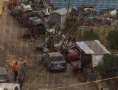 صور.. ورش لتصليح السيارات داخل الكتلة السكنية فى مدينة الحرفين بالسلام