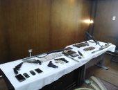 ضبط كيلو حشيش و350 طلقة و7 أسلحة نارية بحوزة 3 عمال بطما فى سوهاج