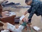 عمال صينيون يذبحون الكلاب لأكلها بحلوان ..صور
