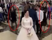 """فيديو وصور .. """"نفسنة"""" بنات تتحول لشجار بسبب """"بوكيه ورد"""" فى حفل زفاف بروسيا"""