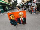 صور.. ترامب وكيم يتصدران قمصان وميادين العاصمة الفيتنامية