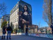 """من اللوفر إلى برلين.. نسخة عملاقة للوحة """"الموناليزا"""" تزين جدارا بألمانيا"""