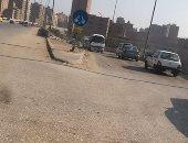 صورة.. سيارة عكس الاتجاه أعلى الطريق الدائرى فى نزلة بكفر طهرمس
