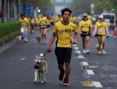 صور.. سباق ترفيهى للكلاب مع أصحابهم فى الفلبين