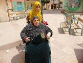 صور.. سيدة سبعينية قعيدة من لجان الوراق: نزلت علشان خاطر الاستقرار