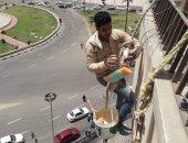 صور.. رفع كفاءة ميدان التحرير ودهان العقارات المحيطة
