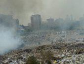 """قارئ يشكو من اندلاع حريق """"متكرر"""" فى القمامة بشارع مجمع المصانع بالزاوية"""