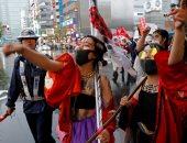 صور.. مسيرة فى طوكيو ضد النظام الإمبراطورى باليابان