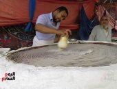 الكنافة والقطايف.. أجواء رمضانية فى الشوارع المصرية