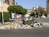 قارئ يشكو من تراكم القمامة بامتداد شارع بورسعيد