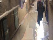 """صور.. مياه الصرف الصحى تغرق شارع بالوارق.. والأهالى:""""محدش سأل فينا"""""""