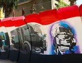 """صور.. """"فيصل"""" يزين جدران معسكر الأمن المركزى برسوم جرافيتى للأبطال بالغربية"""