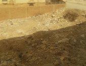 بؤرة تلوث.. شكوى من تحول أرض فضاء بحدائق الأهرام لمقلب قمامة